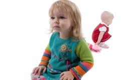 Due babyes che si siedono sul pavimento Fotografie Stock
