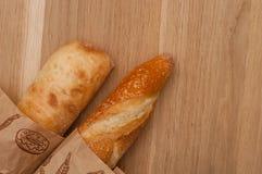 Due baguette su una tavola di legno Fotografia Stock