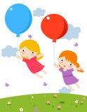 Due bambine sveglie con l'aerostato Fotografia Stock