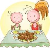 Due bambini alla tavola di banchetto Fotografia Stock