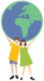 Due bambini che tengono il globo Immagine Stock Libera da Diritti