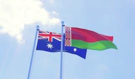 Due bandiere che ondeggiano contro il cielo blu Immagini Stock