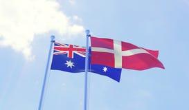 Due bandiere che ondeggiano contro il cielo blu Fotografia Stock