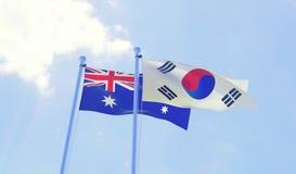 Due bandiere che ondeggiano contro il cielo blu Fotografie Stock Libere da Diritti