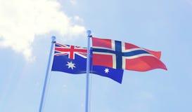 Due bandiere che ondeggiano contro il cielo blu Immagini Stock Libere da Diritti