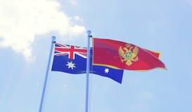 Due bandiere che ondeggiano contro il cielo blu Immagine Stock