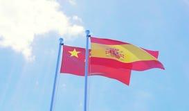 Due bandiere che ondeggiano contro il cielo blu Immagine Stock Libera da Diritti