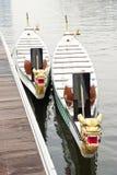 Due barche del drago legate in su al molo Fotografia Stock