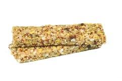 Due barre dei cereali di energia con la frutta rossa, isolata Fotografie Stock Libere da Diritti