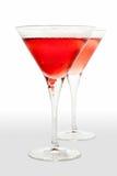 Due bicchieri di vino del martini con colore rosso Fotografie Stock