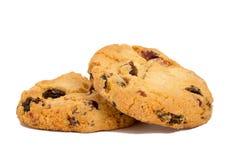 Due biscotti con l'uva passa isolata sopra fondo bianco Fotografia Stock