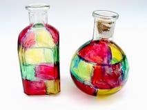 Due bottiglie di vetro fotografie stock