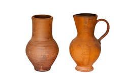 Due brocche antiche dell'argilla Fotografia Stock