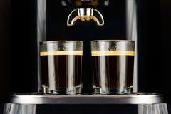 Due caffè espressi in tazze di vetro Fotografie Stock