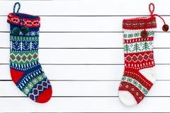 Due calze modellate variopinte di Natale Fotografia Stock