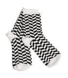 Due calzini in bianco e nero Fotografia Stock