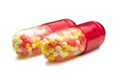 Due capsule rosse Fotografie Stock