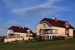 Due case della famiglia immagine stock
