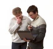 Due con il computer portatile Fotografia Stock