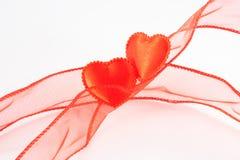 Due cuori di colori rossi Fotografia Stock