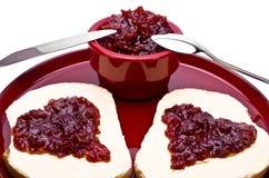Due cuori ed il barattolo pieno per un biglietto di S. Valentino fanno colazione Fotografia Stock