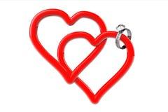 Due cuori rossi con la fede nuziale del diamante Fotografie Stock Libere da Diritti