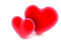 Due cuori rossi di amore su bianco Fotografia Stock