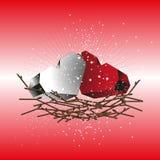 Due cuori rossi e bianchi in un nido dei ramoscelli Immagine Stock