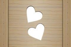 Due cuori in un bordo di legno Fotografie Stock Libere da Diritti