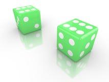 Due dadi nel verde entrambi con sei su Immagine Stock