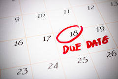 Due Date day, the 18th, Red circled mark on a white calendar, as Royalty Free Stock Image