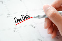 Due Date text on the calendar ( or desk planner) Royalty Free Stock Image