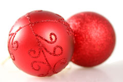 Due decorazioni rosse di natale Fotografie Stock