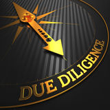 Due Diligence - Golden Compass Needle. Stock Photo