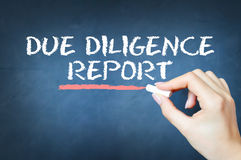 Due diligence report text written with chalk on blackboard Stock Images