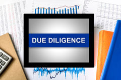 Due diligence word on tablet Royalty Free Stock Photos