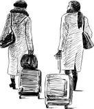 Due donne con le valigie in un viaggio Fotografia Stock Libera da Diritti