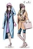 Due donne di modo Belle donne alla moda disegnate a mano in vestiti di inverno Attrezzature di inverno di modo illustrazione vettoriale