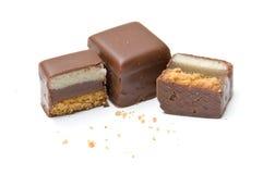 Due e un cioccolato riempito mezzo Immagini Stock Libere da Diritti