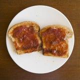 Due fette di pane tostato Fotografia Stock