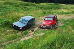 Due fuori dal veicolo stradale Immagine Stock