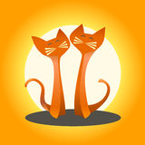 Due gatti nell'amore su un fondo arancio Immagini Stock
