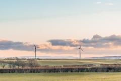 Due generatori eolici un giorno scozzese freddo in autunno Fotografia Stock Libera da Diritti
