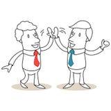 Due genti di affari alte--fiving Immagini Stock