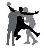 Due giocatori di pallamano che bloccano giocatore avversario Immagine Stock