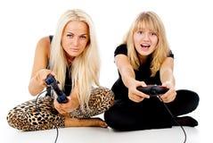 Due giochi del gioco delle ragazze video Immagini Stock Libere da Diritti