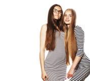 Due giovani operai isolati su bianco, gli stessi vestiti nella striscia Immagine Stock