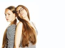 Due giovani operai isolati su bianco, gli stessi vestiti nella striscia fotografia stock