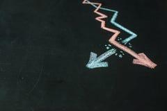 Due grafici sono attinti la lavagna con gesso Immagine Stock