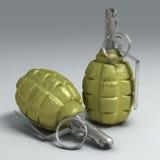 Due granate a mano di frammentazione su superficie chiara Fotografia Stock Libera da Diritti